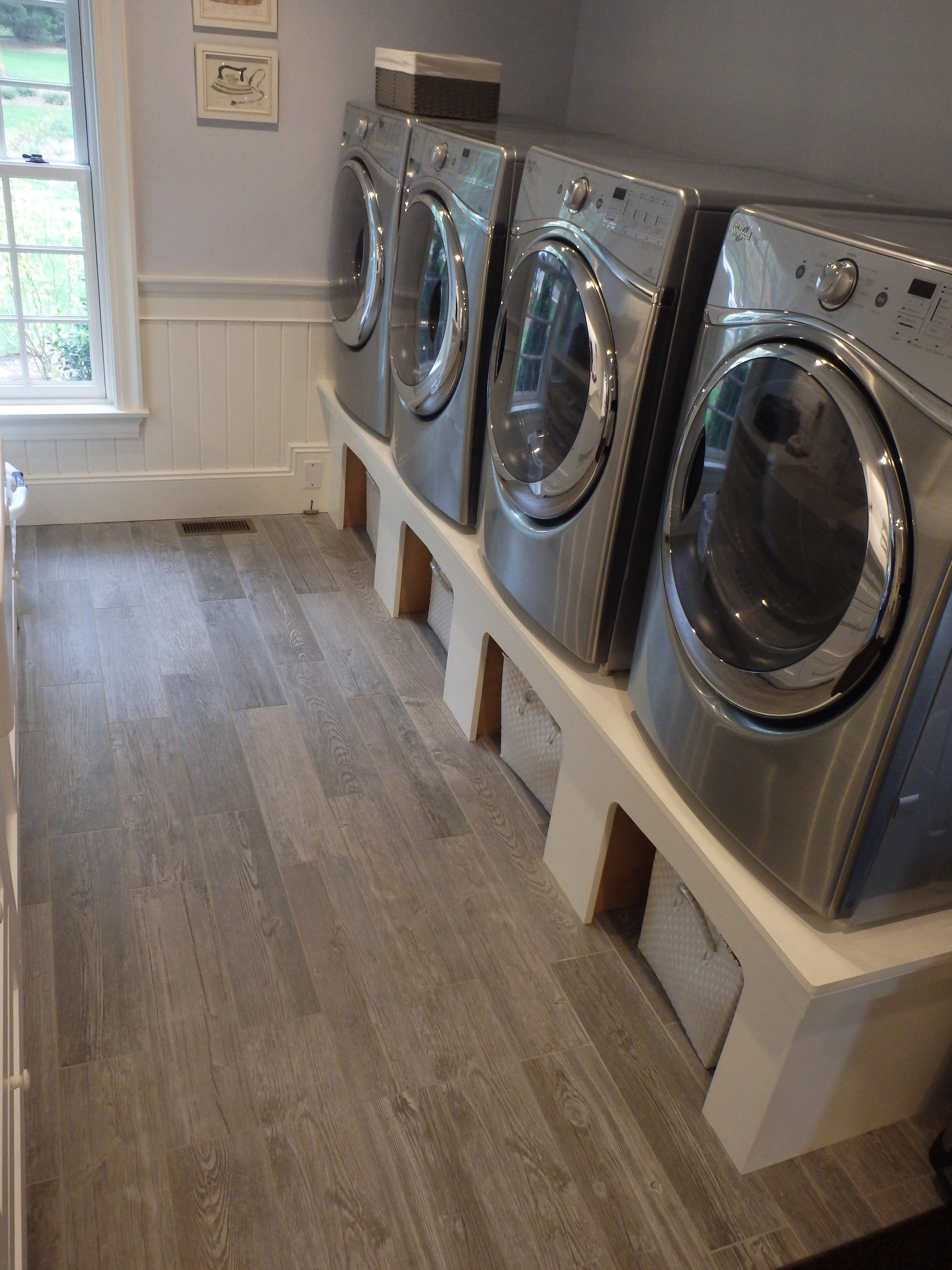 Inspiring living spaces Wood look porcelain used for this laundry