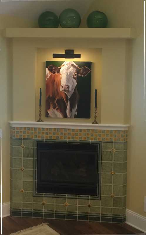 Fireplace tile tilery cape cod . love the cow.