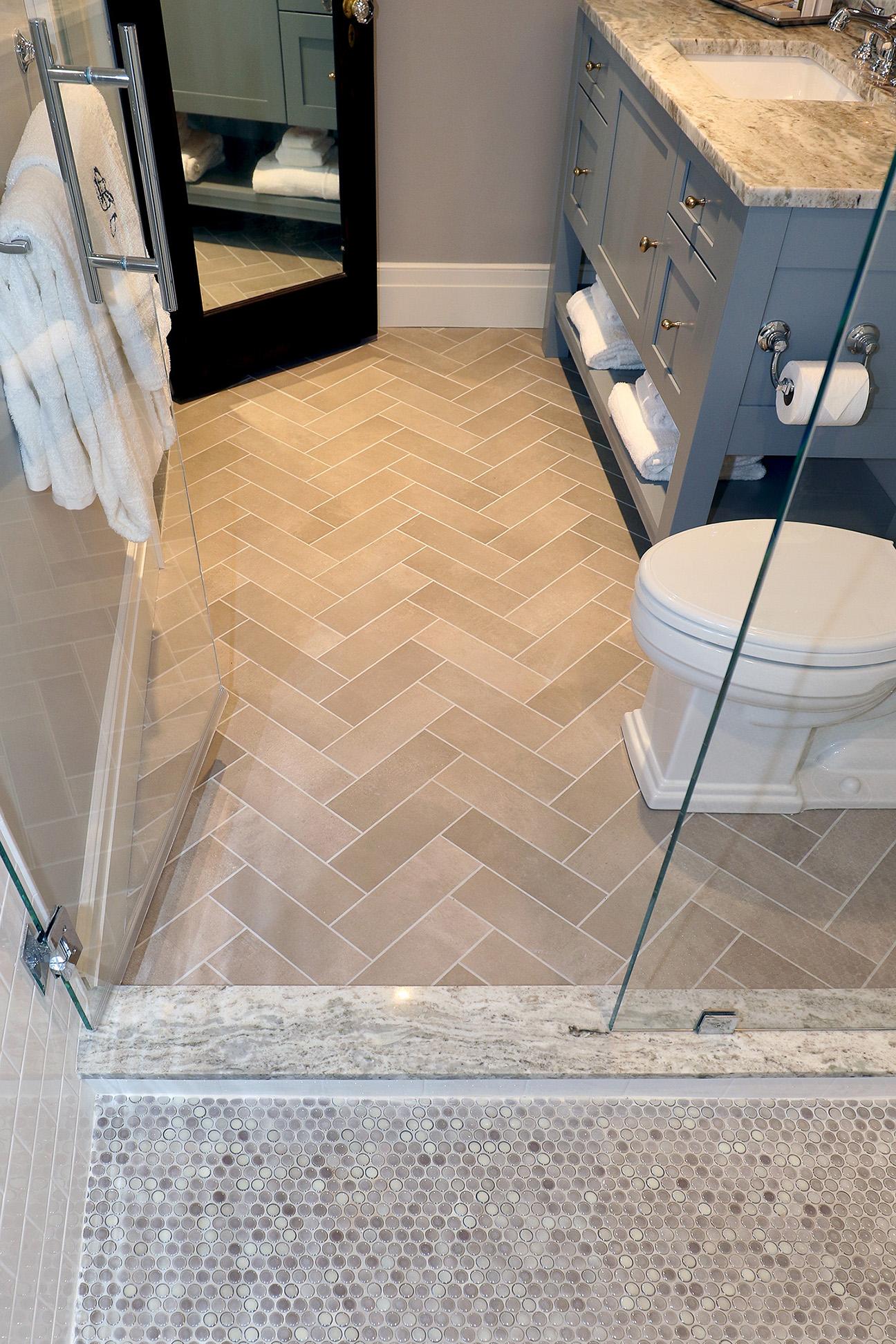 Porcelain Herringbone Bathroom Floor.  The Tilery Penny Roundsandherringbonebath